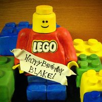 Legos's! Lego mad is out of crispy treats covered in MMF, the rest is cake :) Very fun cake to do! Birthday banner and hands are out of gumpaste.