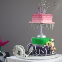 Diva Fashionista Sweet 16 Rotating B-Day Cake  This cake was done for my final exam in school, its a coffee buttercream sponge cake covered with fondant and then airbrushed to get the...