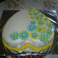 Flow Of Flowers Its a marble cake covered in fondant with blue and yellow gumpaste flowers,