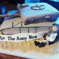 Army Tank - Going Away Party This was a chocolate cake with dark chocolate ganache filling and chocolate buttercream. The figurine and banner were made with gum paste....