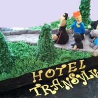 Hotel Transylvania   Yellow Cake covered in B/C. All characters made of fondant.