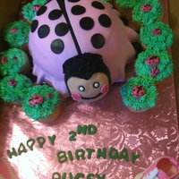 Lady Bug Cake made for a 2 year old girl's b-day. vanilla cake covered in fondant. cupcakes covered in buttercream.