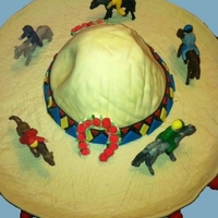 Cinco De Mayo Derby   Chocolate fudge cake with mint icing. Covered in fondant. Horses, Jockey's and Roses are made of gumpaste.