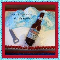 Coor's Light Cake  1/2 sheet cake covered in b/c. Sugar beer bottle with edible label. Label has name & date of birth of recipient. Mountain made with...
