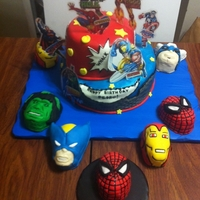 Super Heroes Cake  A 2-tier cake with strawberry cake and fudge marble tiers. Rolled buttercream with fondant accents. Cakelets in the super heroes are cake...