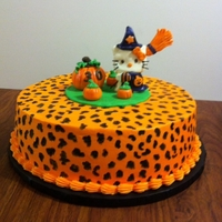 "Hello Kitty Witch Cake   This is a 12"" round pumpkin cake with cream cheese filling. 4"" tall cake. All fondant topper, cheetah spots hand painted."