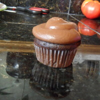 Mini Tripple Chocolate Cupcakes Chocolate cupcake base, chocolate filling, chocolate fudge frosting