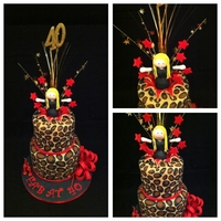 Cheetah Print Cake With A Girl Jumping Out If It Double tier with cheetah print & red with a girl popping out with an explosion.