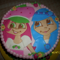 Strawberry Shortcake This is a Strawberry Shortcake themed birthday cake. Cake is chocolate with vanilla buttercream and the figures are done in MM fondant....
