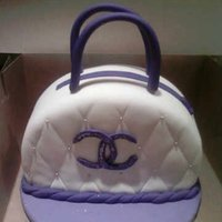 Channel Purse Cake this channel purse was make out of purple velvet cake with cream cheese icing.