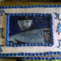 Jusdaone Birthday My friend ordered this cake for her son's birthday. Her son like to rap sing. it was my 1st photo cake, headphones & mic.
