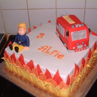 Fireman Sam   Chocolate sponge with chocolate and vanilla frosting. Fire engine is RKT and fireman sam is all icing, everything is edible.