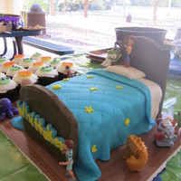 Toy Story Bed Orange cake, sugar cookie headboard covered in royal icing. I didn't make the figures.