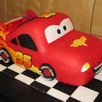Lightning Mcqueen 3D Lightning McQueen. All fondant, coloring on flames is done with petal dust. Thanks for looking :)
