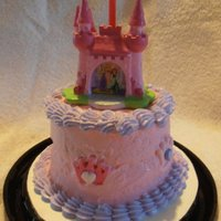 Princess Cake And Smash Cake For A 1St Birthday  This is the smash cake for the soon to be 1 year old. I found this adorable candle holder and the icing crowns. This cake is Pink with...