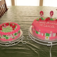 Strawberry Shortcake Buttercream with fondant accents. The strawberries are fondant but the dolls and cat are toys.