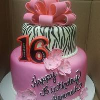 Sweet 16 Birthday Cake *Hot pink and hand painted zebra stripes with a fondant bow and fantasy flowers.