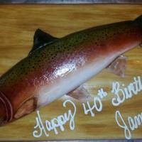 Rainbow Trout Birthday Cake *Marble cake covered with MMF and painted with a woodgrain. The trout is marble also with MMF. It is airbrushed and varnished.