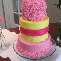Pink And Yellow My first time making a 3-tier and it was a hit! I meant to have the roses on the bottom tier, too, but I ran out of frosting (I added the...