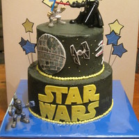 Star Wars! I love how this one came out! Buttercream with fondant accents. The signs are paper. Action figures borrowed from birthday boy.