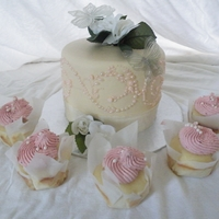 Duane & Jenilee WASC cake with strawberry filling and cupcakes are also WASC with strawberry buttercream. Gelatin butterflies with silk flowers.