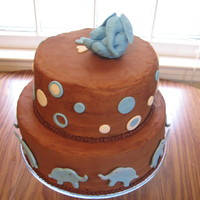 Elephant Baptism Cake Chcolate buttercream with yellow cake and elephants