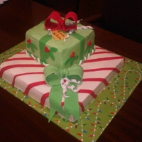 Christmas Packages Chocolate cake with buttercream frosting and fondant accents. My first time making bows!