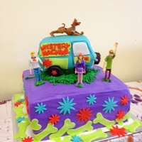 Scooby Doo Mystery Machine My grand-daughter's 4th birthday cake!! She loves Scooby and loved her cake. Working head lights. It was a lot of fun to make.
