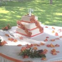 Fall Wedding Cake Abby & Laura's wedding pumpkin spice cake with vanilla buttercream and Satin Ice white fondant