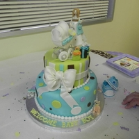 Moderm Mama Baby Shower Cake   The Idea was from The pink cake box Web side. I learn how to do the Crib and the pregnant lady with cakeschool.com.