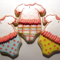 Baby Girl Onesies Ruffled baby girl onesies. Vanilla sugar cookies with a modified RI. Sorry for the poor quality photo; had to take it at night!