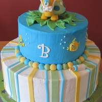 "Baby Shower Turtle Cake Cake for a turtle-themed baby shower. 12"" bottom tier was chocolate fudge cake w/cookies & cream filling. 8"" top tier was..."