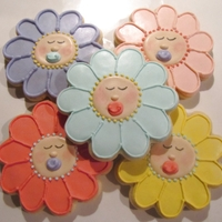 Sleeping Baby Flower Faces Baby flower faces for a baby shower. Vanilla sugar cookies with a modified RI. Pink petal dust on cheeks. Design inspired by Sugarbelle....