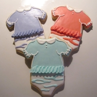 Ruffled Baby Girl Onesies Baby girl onesies with ruffles & zebra stripes. Vanilla sugar cookies with a modified RI. Sorry for the poor quality photo; had to take...