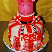 Olivia The Pig made this cake for a friend's daughters 4th birthday, yellow cake with strawberry and banana filling.