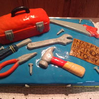 Birthday Tool Cake I made this for my Husband's co-workers birthday. He loves his tools n tool box. I made the Happy Birthday Sign to look like wood.