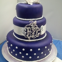 Purple Majesty Wedding cake for Russian couple. Fondant-spray paint-sugar gum flowers-gold, silver, purple dust.