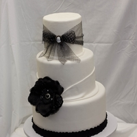 Black/white Wedding Cake Cake I made for a bridal show. I used pre-made fondant and had a ROUGH time. Not sure why because I now people use it w/o any problems.