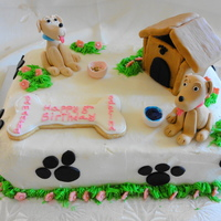 Twin Dog Cake This cake was made for twin girls. Both dogs are made of gumpaste. The house is graham crackers covered in fondant. The cake is covered in...