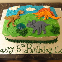 Dinosaurs Vanilla cake with vanilla filling (the birthday boy's request). Covered in buttercream with gumpaste dinosaurs hand painted. He...