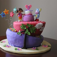 Dora Topsy Turvy done this cake for my daughter's 4th birthday didn't want to use a traditional candle instead i made 4 stars to represent the...