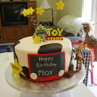 Toy Story Half chocolate, half vanilla. Buttercream with fondant accents. Characters are toys.