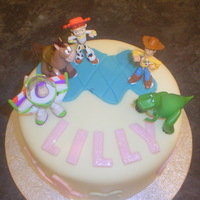 Toy Story 3 A vanilla 3 layer sponge with vanilla bc and strawberry jam filling covered in fondant .For my beautiful granddaughter's third...