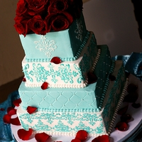 Square Wedding Cake The brides colors were 'Tiffany Blue' and red. Im so happy we didn't incorporate the red into the frosting. I think the...