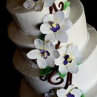 Orchid Wedding Cake Bride and groom also wanted the tiers to be tapered in slightly.
