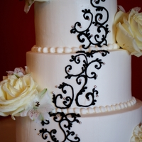 Black Scrolling Bride sent a picture of what she wanted. White cake, black detail and flowers to match. Flowers provided by the florist. I wish I would...