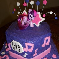 Star Song Pony buttercream frosted with fondant accents