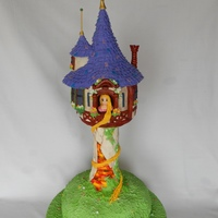 Tangled Cake This is a cake I did for a 3 year old. It's based on the movie Tangled. It's built on a wooden board with a PVC pipe up the...