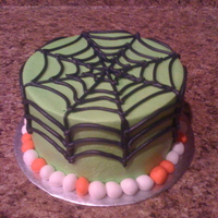 "Spiderweb! 6"" cake. lime green. Wish I had green and black fondant for the border but the orange and white still looks pretty cute. Hand did the..."