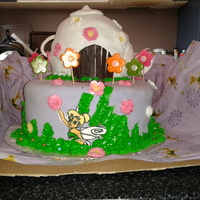 Tinkerbell  My niece's birthday cake.I only had a couple of days to bake and decorate and realised too late that the teapot was not round and the...